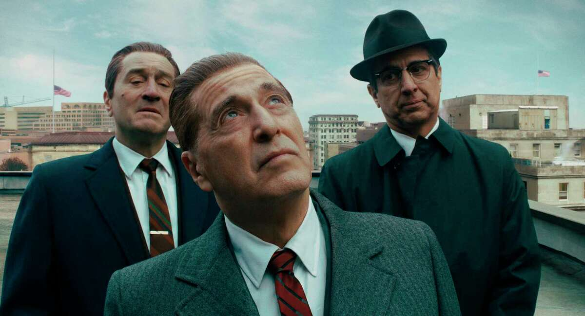 """This image released by Netflix shows, from left, Robert De Niro, Al Pacino and Ray Romano in a scene from """"The Irishman."""" On Dec. 9, Pacino was nominated for a Golden Globe for best supporting actor in a motion picture for his role in the film."""