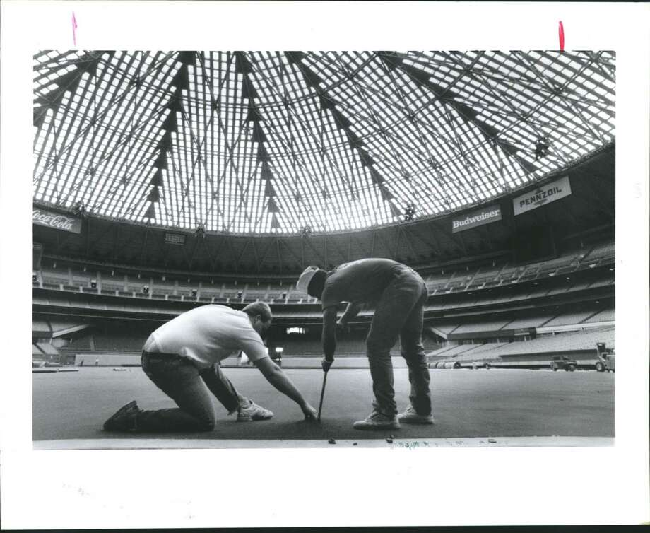 Houston Astrodome workers put the finishing touches on the AstroTurf before Monday's opening-day game against Cincinnati. The groundbreaking for the Astrodome was held Jan. 3, 1962. Photo: Betty Tichich, HC Staff / Houston Chronicle / Houston Chronicle