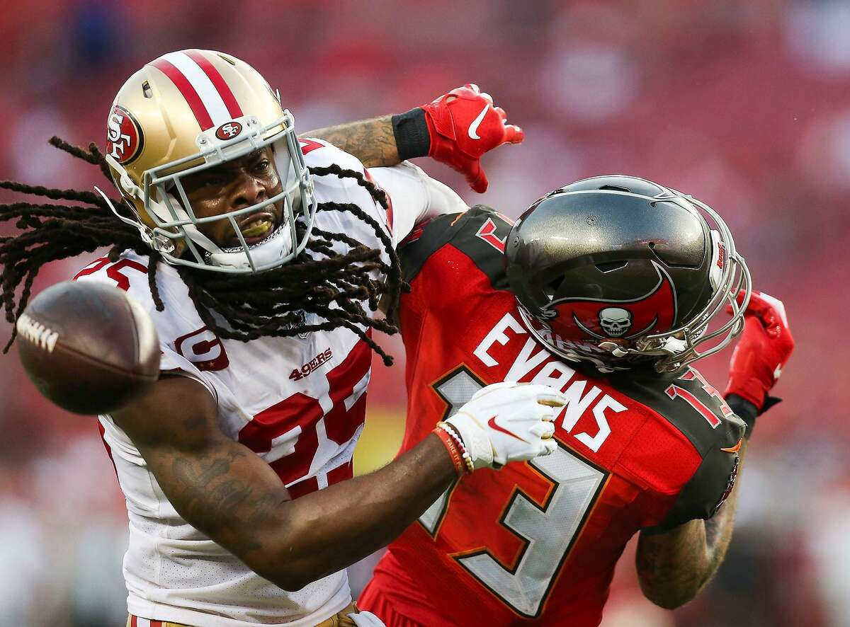 Tampa Bay Buccaneers wide receiver Mike Evans (13) is unable to come up with the catch as he is covered by San Francisco 49ers cornerback Richard Sherman (25) on a 4th-and-6 on the Bucs' last drive of the fourth quarter on September 8, 2019, at Raymond James Stadium in Tampa, Fla. (Dirk Shadd/Tampa Bay Times/TNS)