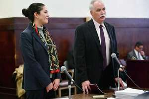State's Attorney Justina Moore, left, appears at Superior Court in New Haven with her attorney Eugene Riccio Jan. 3.