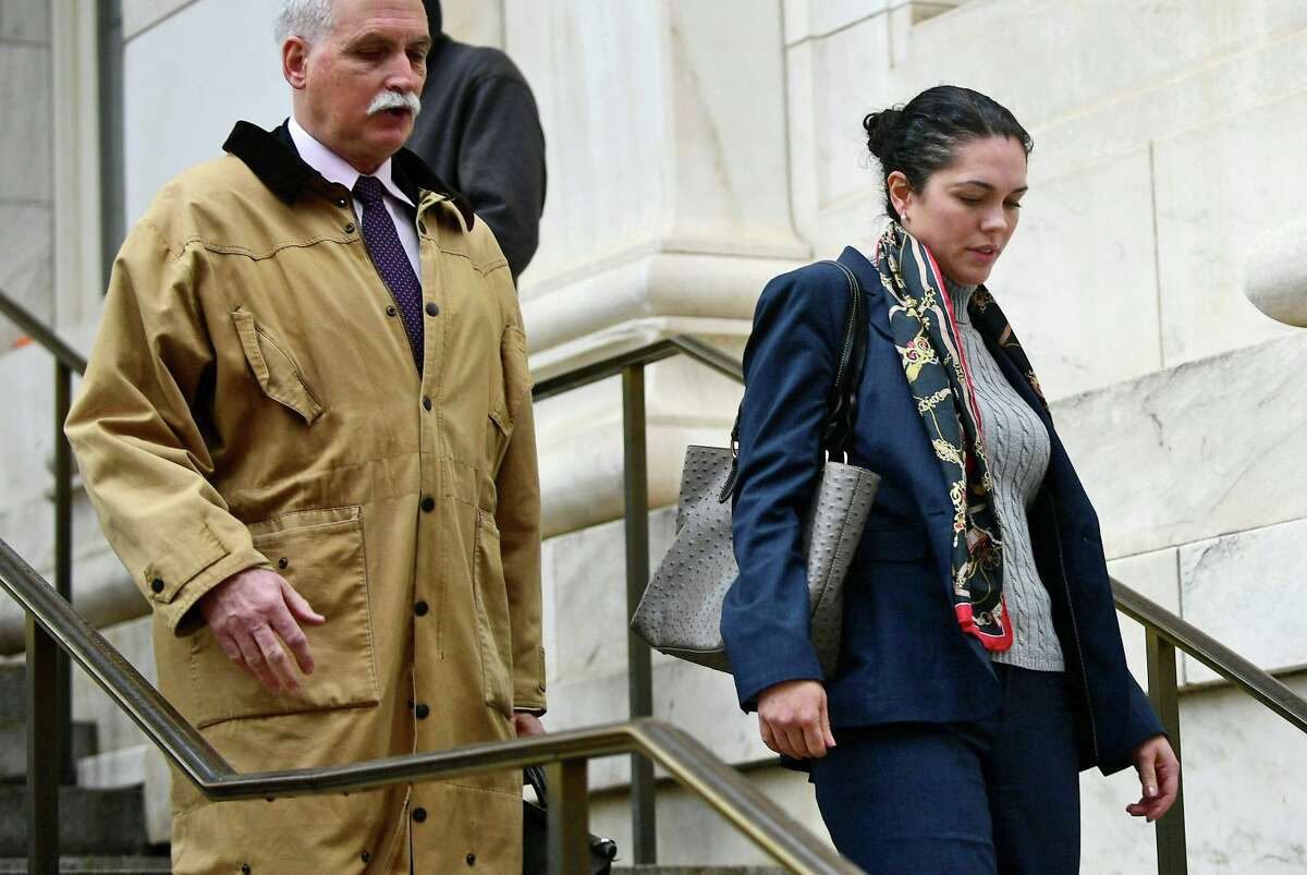 State's Attorney Justina Moore, right, outside Superior Court in New Haven with her attorney Eugene Riccio Jan. 3.