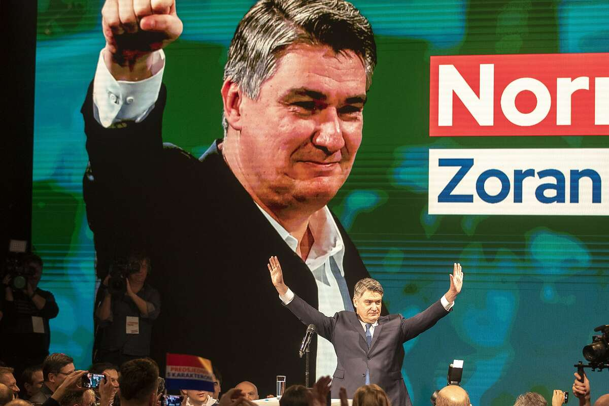 In this Sunday, Dec. 22, 2019, file photo, presidential candidate Zoran Milanovic greets his supporters in Zagreb, Croatia, Croatia's bitterly contested presidential race is headed for a finale this weekend to decide whether a conservative or a liberal will lead the country during its first ever chairmanship over the European Union. (AP Photo/Darko Bandic, File)