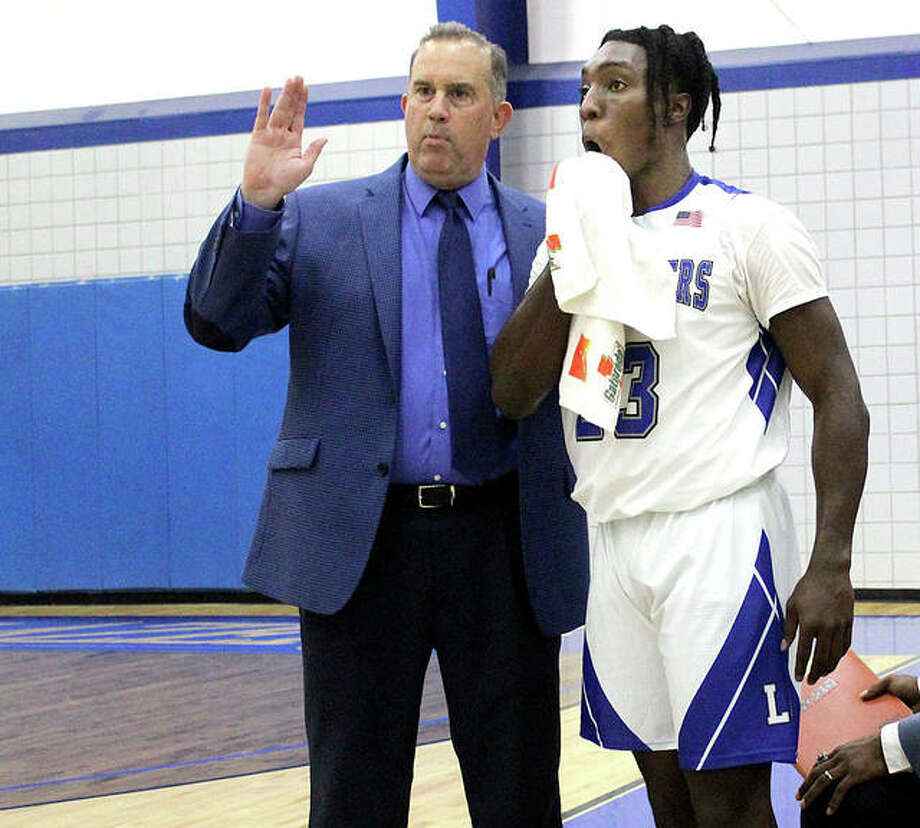 Lewis and Clark basketball coach Doug Stotler gives instructions to DeAngelo Ware during a timeout. Wednesday night, Ware scored 12 points in the Trailblazers' 73-62 Thursday night victory over St. Louis Community College at the River Bend Arena. Photo: Pete Hayes | The Telegraph