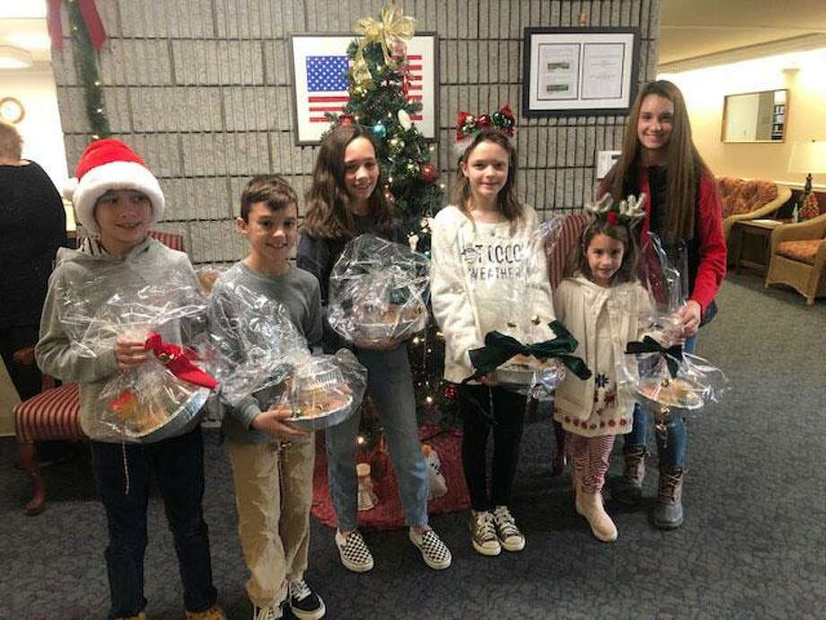 Helping the Wilton Woman's Club were, from left, Johnny Bittner, Nathan Partenza, Piper Bittner, Charlotte McCall, Chloe Partenza and Ava Partenza. Photo: /