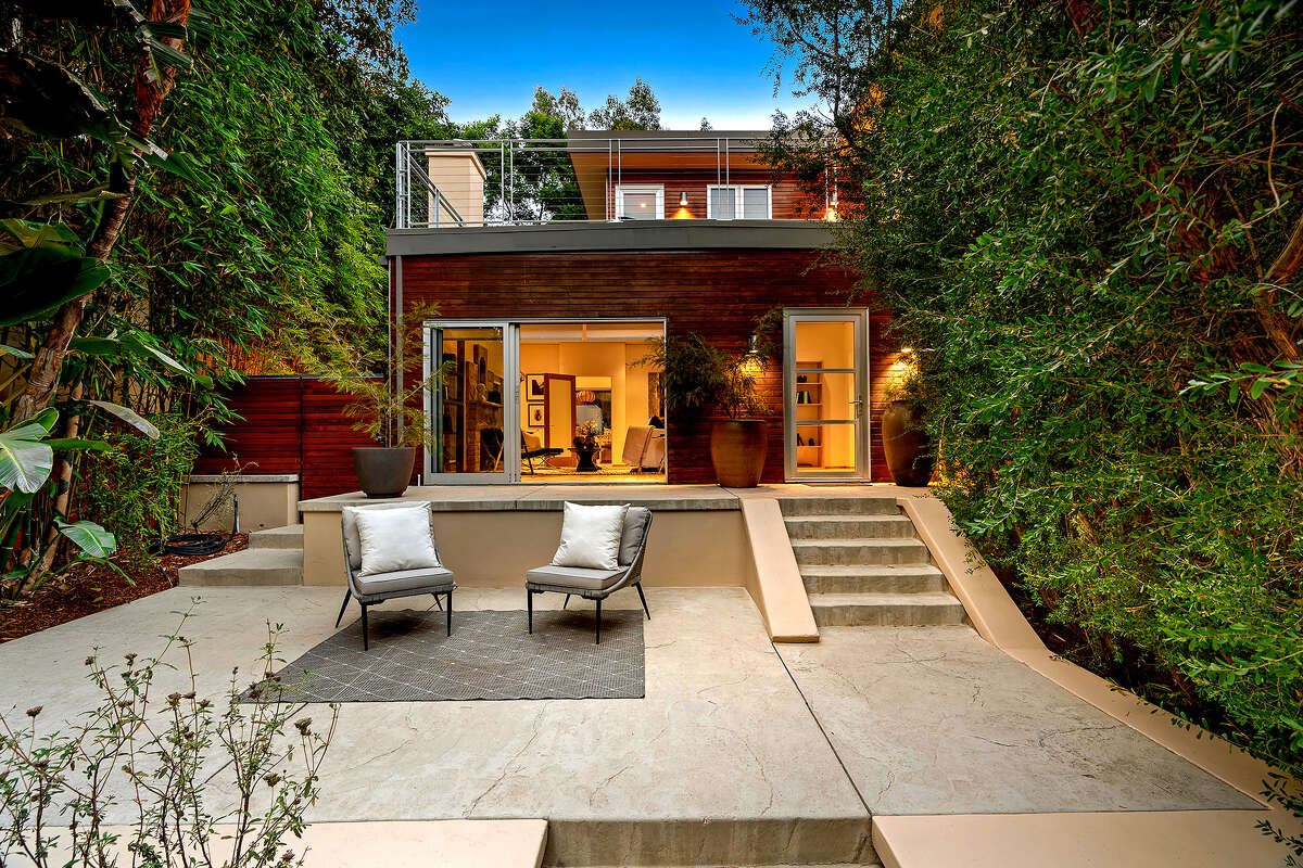 Actor Josh Lucas renovated his 1920s home in the Hollywood Hills to create an eco-friendly residence. Tall bamboo and fences hide the contemporary-style home from the street. Beyond the gates, a series patios fill the tiered courtyard. Listed for $2.298 million, the two-story home has bi-folding doors, stone fireplaces and a galley-style chef's kitchen. The master suite opens to a wrap-around balcony. (Erik Grammer/TNS)