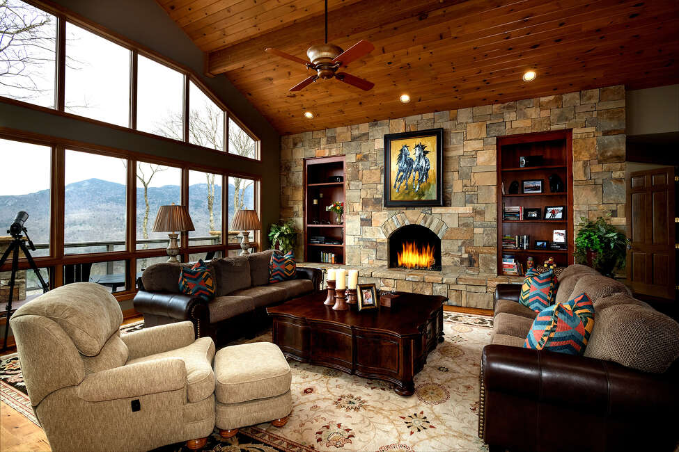 NASCAR legend Rusty Wallace is asking about $1.6 million for his four-bedroom home in North Carolina. A two-story great room with a stone fireplace anchors the single-story home. Walls of windows and outdoor decking take in sweeping mountain vistas. (Tommy White/TNS)