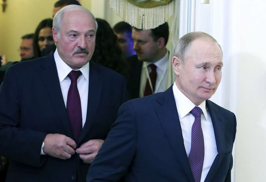 FILE - In this file photo taken on Friday, Dec. 20, 2019, Russian President Vladimir Putin, right, and Belarusian President Alexander Lukashenko walk before a meeting of the Supreme Eurasian Economic Council in St. Petersburg, Russia. Russia has halted oil supplies to Belarus Friday Jan. 3, 2020, after the two countries failed to renegotiate a contract amid talks of further improving their economic ties. (Mikhail Klimentyev, Sputnik, Kremlin Pool Photo via AP, File) Photo: Mikhail Klimentyev / Associated Press