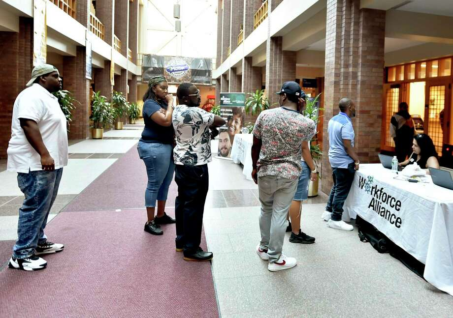 People line up to pre-register for interviews for positions at the Amazon North Haven distribution center, during a job fair at City Hall in New Haven, Conn., on Aug. 30, 2019. Three months later, Connecticut recorded a monthly of Photo: Peter Hvizdak / Hearst Connecticut Media / New Haven Register
