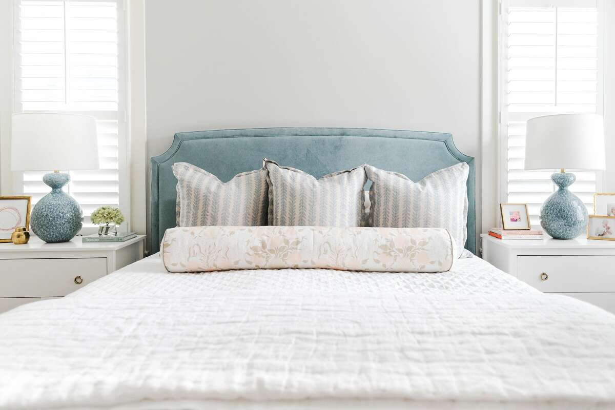 Cool blues add accents to a calm, neutral master bedroom.
