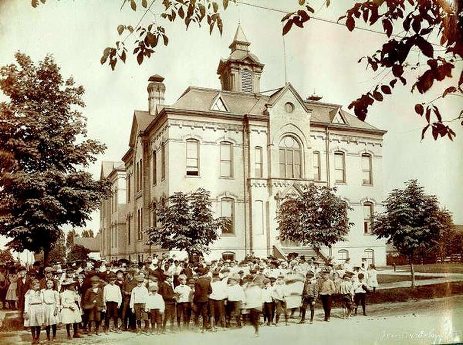 School children gather in front of the Union School in this photograph from 1904.