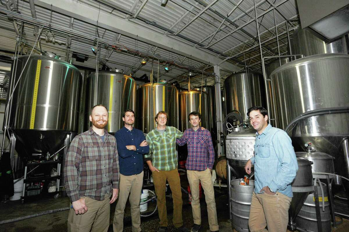 From left, Tom Price, Jordan Giles, Grant Gyesky, Stuart DeVan, and Conor Horrigan pose inside Half Full Brewery in Stamford, Conn. on Tuesday, Oct. 11, 2016.