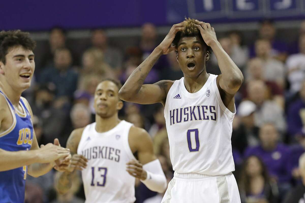 Washington's Jaden McDaniels (0) reacts after being called for a foul against UCLA's Jaime Jaquez Jr., left, in the first half of an NCAA college basketball game Thursday, Jan. 2, 2020, in Seattle. (AP Photo/Elaine Thompson)