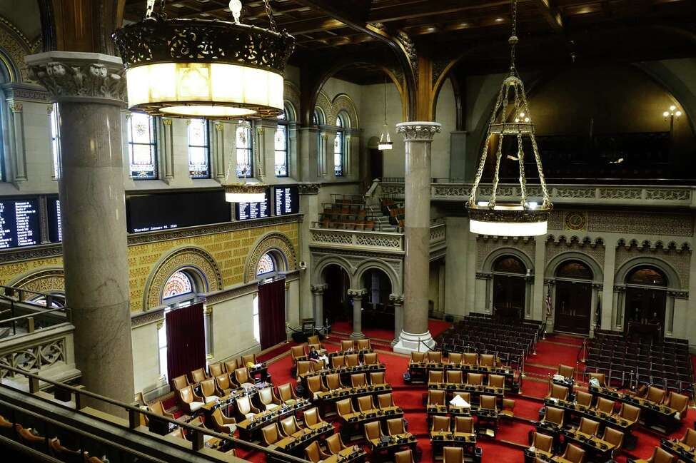 Legislator's desks are cleaned on the floor of the New York State Assembly chamber on Thursday, Jan. 2, 2020, in Albany, N.Y. (Paul Buckowski/Times Union)