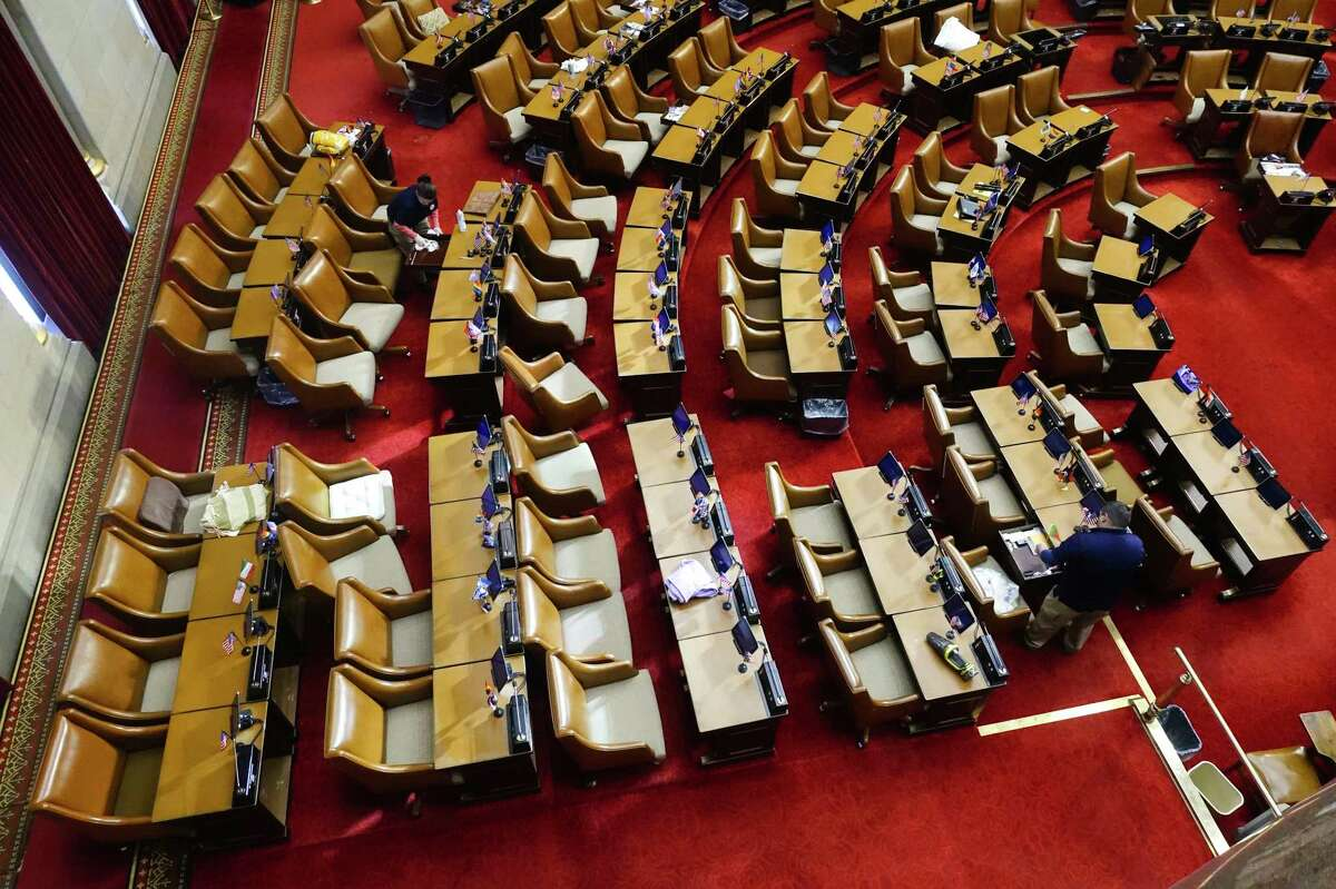 Legislator's desks are cleaned on the floor of the New York State Assembly chamber earlier this year in Albany, N.Y. (Paul Buckowski/Times Union)