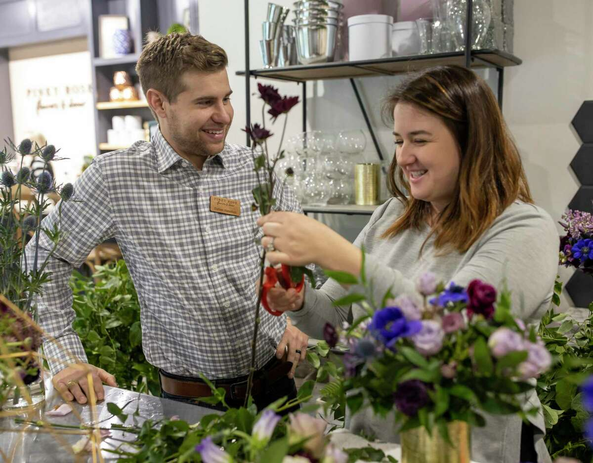 Cullen Handfelt and Taylor Handfelt share a laugh while arranging a floral vase, Thursday, Jan. 2, 2020. Taylor Handfelt established Piney Rose in 2016 but only recently opened a physical location.