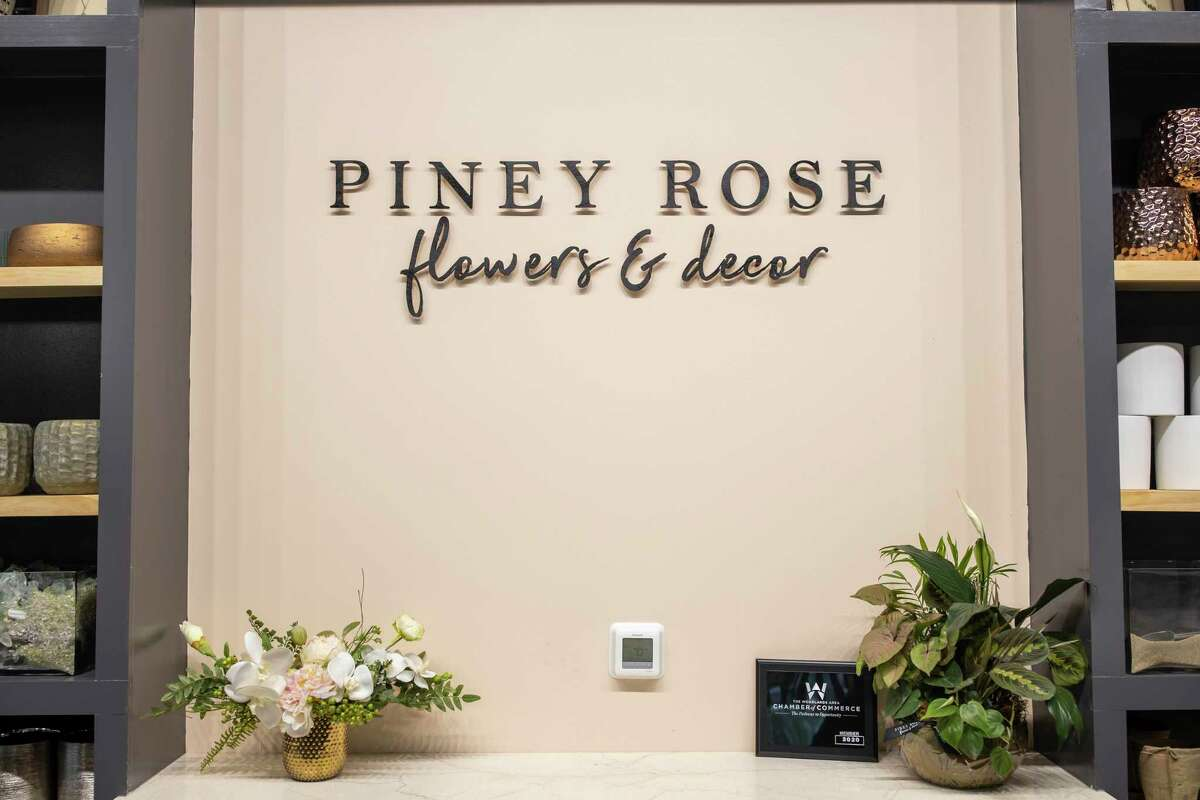 A handmade shelving space and sign is set behind a counter top inside Piney Rose, Thursday, Jan. 2, 2020. Piney Rose was established in 2016 by Taylor Handfelt and will host it's grand opening for it's store location in the Woodlands on Jan. 18, 2020.