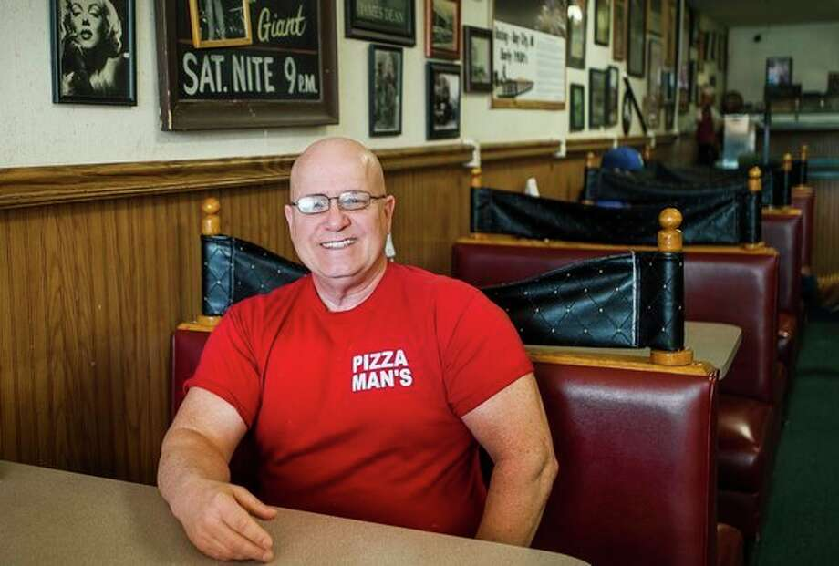Coleman Mayor Steve Miller poses for a portrait inside his restaurant, Pizza Man, in downtown Coleman. (Katy Kildee/kkildee@mdn.net)