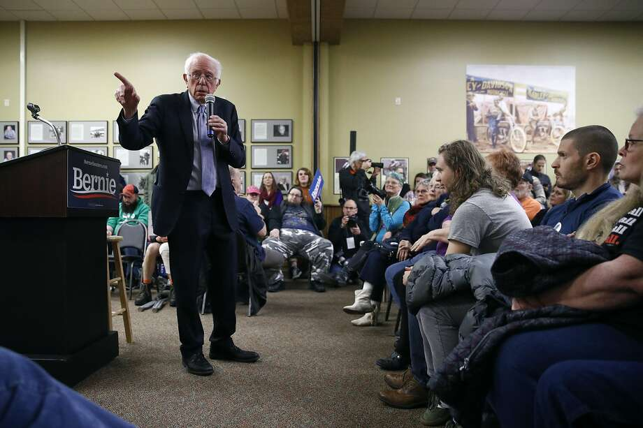 "Presidential candidate Bernie Sanders meets voters in Anamosa, Iowa. He criticized President Trump for what he called a ""dangerous escalation."" Photo: Patrick Semansky / Associated Press"