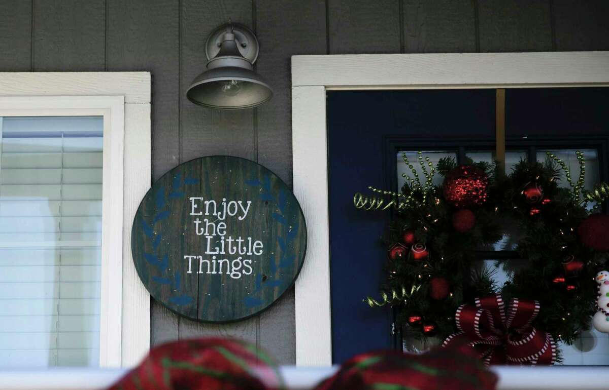 A sign on the porch at a home in Bluebonnet Ridge RV Park & Cottages on Wednesday, Dec. 11, 2019 in Terrell.