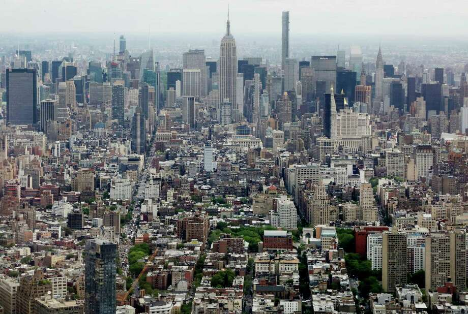 The Empire State Building, as seen from the observatory at One World Trade Center in New York, is one of many destinations that are off-limits in the return to old-fashioned summer. Photo: Associated Press / Copyright 2018 The Associated Press. All rights reserved.