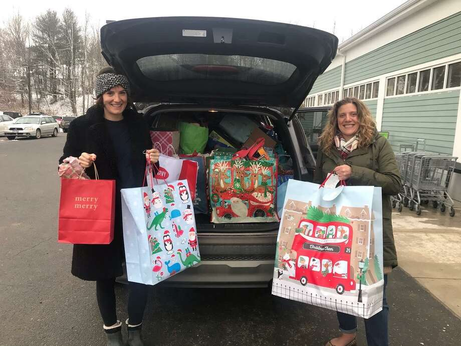 New Morning Market staff members with their Angel Tree donations. Photo: Contributed Photo