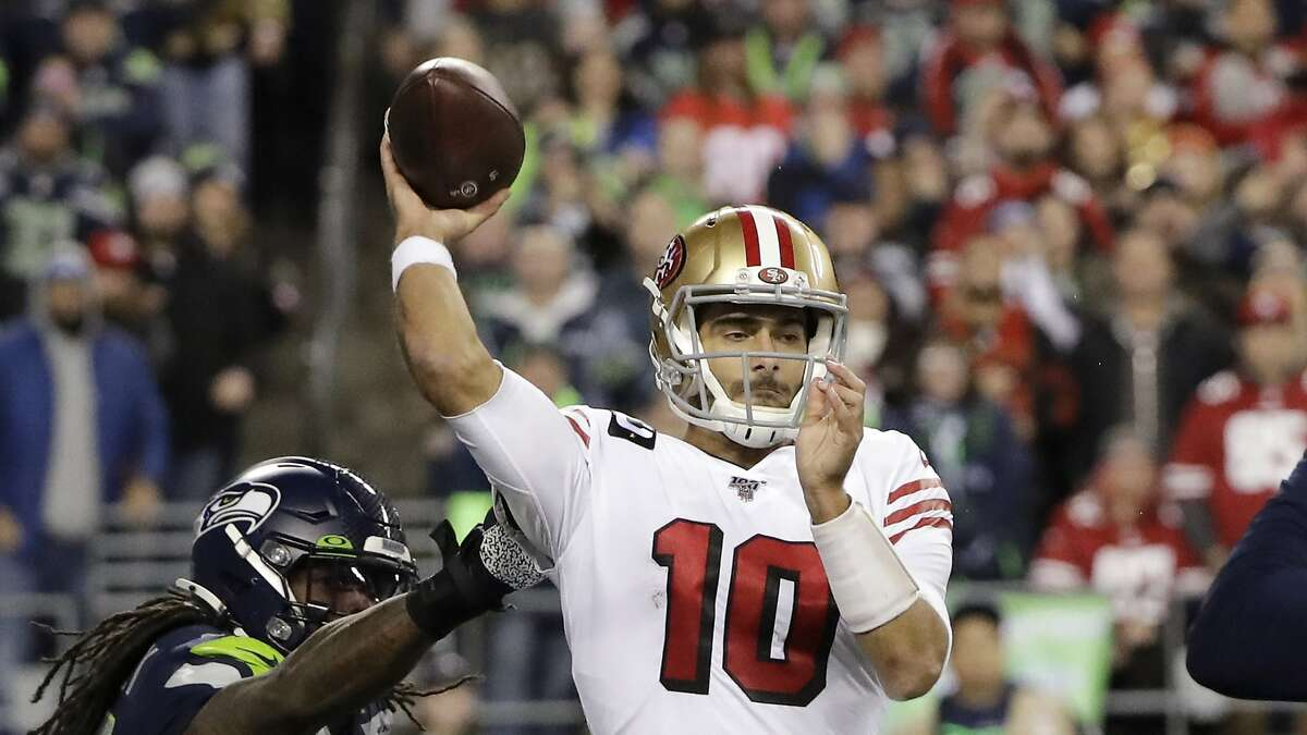 San Francisco 49ers quarterback Jimmy Garoppolo in action against the Seattle Seahawks during the second half of an NFL football game, Sunday, Dec. 29, 2019, in Seattle. (AP Photo/Ted S. Warren)