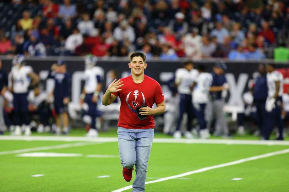 West Houston's Kaleb Gonzalez is all smiles after picking up the tee from the opening kickoff of the Houston Texans recent home gain against the Tennessee Titans. Gonzalez' name was drawn as a winner of the Ashley HomeStore Kickoff Kid program. Photo: Courtesy By?Ashley HomeStore