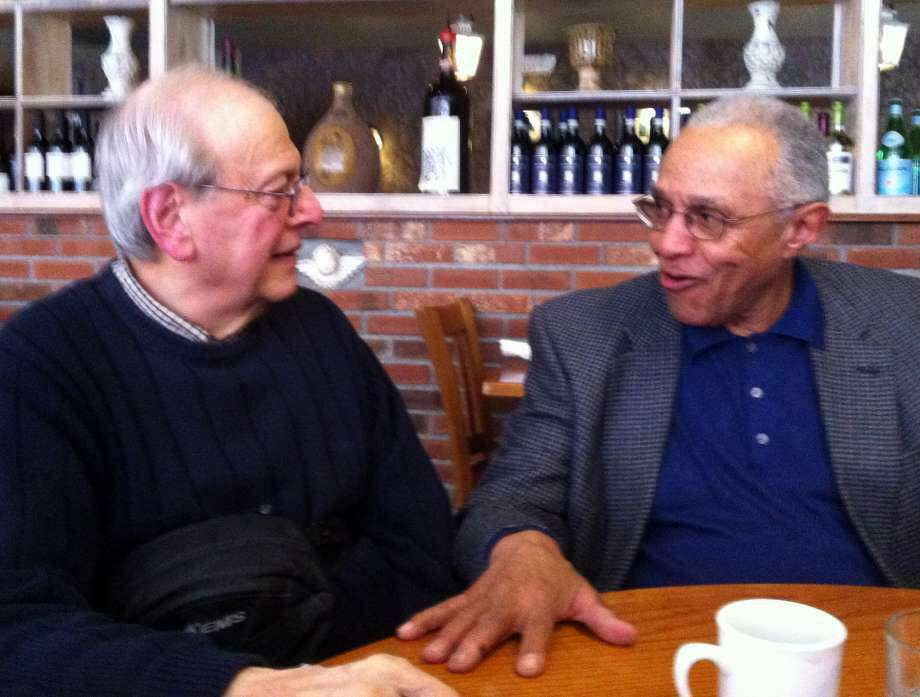 Stephan Lesher, left, and Sam Hyman, right, meet over lunch in 2015 to discuss their perspectives on the civil rights movement. Photo: Jacqueline Smith / Hearst Connecticut Media