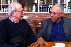 Stephan Lesher, left, and Sam Hyman, right, meet over lunch in 2015 to discuss their perspectives on the civil rights movement.