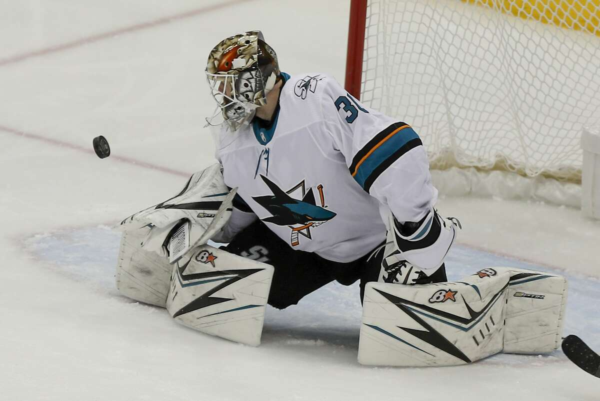 San Jose Sharks goaltender Aaron Dell stops a Pittsburgh Penguins shot during the third period of an NHL hockey game Thursday, Jan. 2, 2020, in Pittsburgh. The Sharks won 3-2 in overtime. (AP Photo/Keith Srakocic)