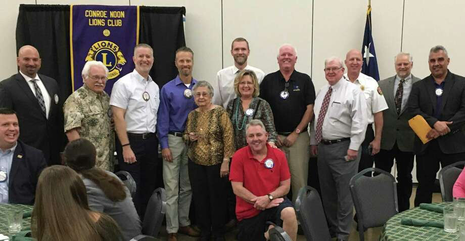 Recently members of the Conroe Noon Lions Club received award pens from Lions Clubs International for sponsoring new members during the Centennial celebration years. Pictured: (l-r) Steve Williams, Ray Steinmann, Rich Sproba, Mike Sproba, Ladoris Cates, Zak Stephens, Caroline McWilliams, Mike Godsey, Donnie Buckalew, Ken Kreger, Scott Perry, Ralph Perez, front, Bruce Wade. Photo: Courtesy Photo