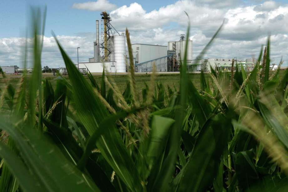 An ethanol plant stands next to an Iowa cornfield. Photo: Charlie Riedel /Associated Press / AP2013