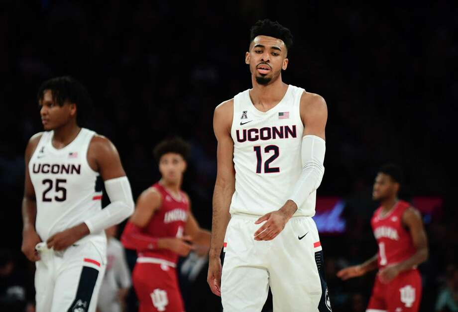 NEW YORK, NEW YORK - DECEMBER 10: Tyler Polley #12 of the Connecticut Huskies reacts during the second half of their game against the Indiana Hoosiers at Madison Square Garden on December 10, 2019 in New York City. (Photo by Emilee Chinn/Getty Images) Photo: Emilee Chinn / Getty Images / 2019 Getty Images