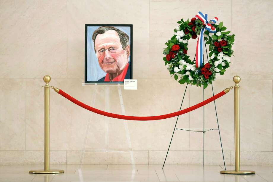 A painted portrait of the late 41st President George H.W. Bush — painted by his son, President George W. Bush — and a memorial wreath grace the atrium area of the George H. W. Bush Presidential Library and Museum in University Park, Texas. A reader who recently visited the museum wonders how President Donald Trump will be remembered. Photo: Tom Fox /Staff Photographer / The Dallas Morning News