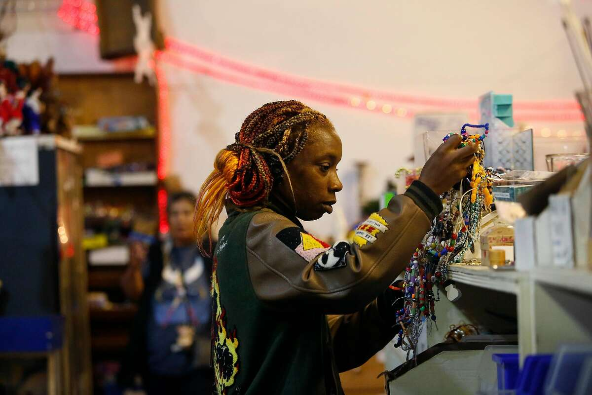Shannan Gibson of San Francisco looks through items for a sewing project while shopping at SCRAPS on Thursday, December 12, 2019 in San Francisco, Calif.