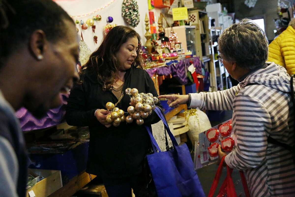 Dorothy Yuki (right) of San Francisco and her daughter Miya Carpenter (left) discuss some finds at SCRAPS for an upcoming family Christmas gathering on Thursday, December 12, 2019 in San Francisco, Calif.