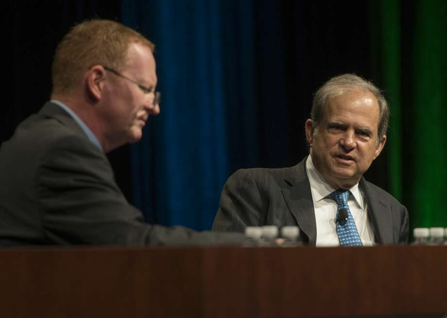 Scott Sheffield, right, chairman and CEO of Pioneer Natural Resources, talks with Steve Toon, editor-in-chief of Oil and Gas Investor with Hart Energy, during the Executive Oil Conference on Nov. 8, 2016. At an oil conference in 2012, Sheffield had predicted Midland's population would reach 150,000-200,000 within 10 years. Photo: Tim Fischer/Midland Reporter-Telegram