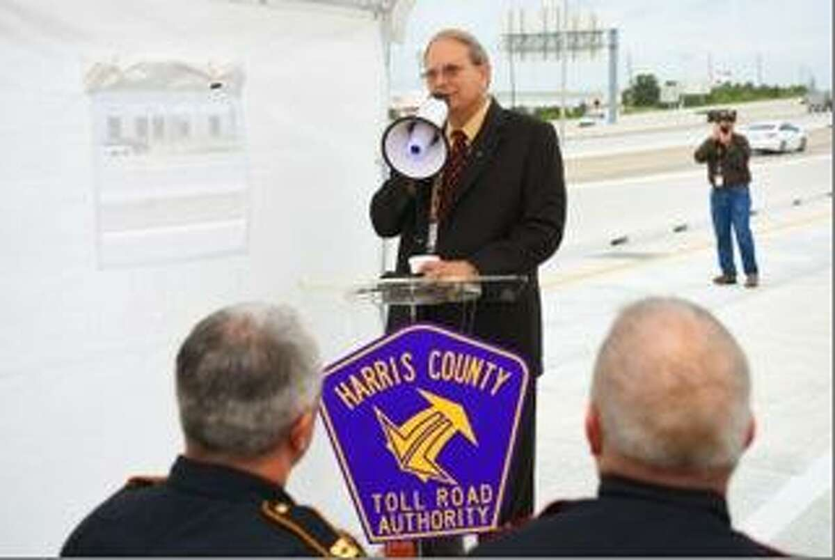 Harris County Toll Road Authority Executive Director Gary Trietsch address ceremony attendees at the 2015 opening of a new ramp along Texas 249.