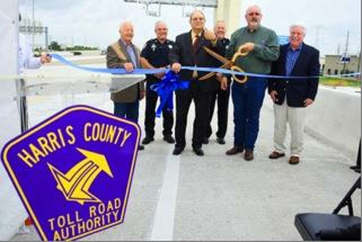 Harris County Precinct 4 Commisioner R. Jack Cagle and Harris County Toll Road Authority Executive Director Gary Trietsch cut the ribbon to celebrate at the 2015 opening of a new ramp along Texas 249.