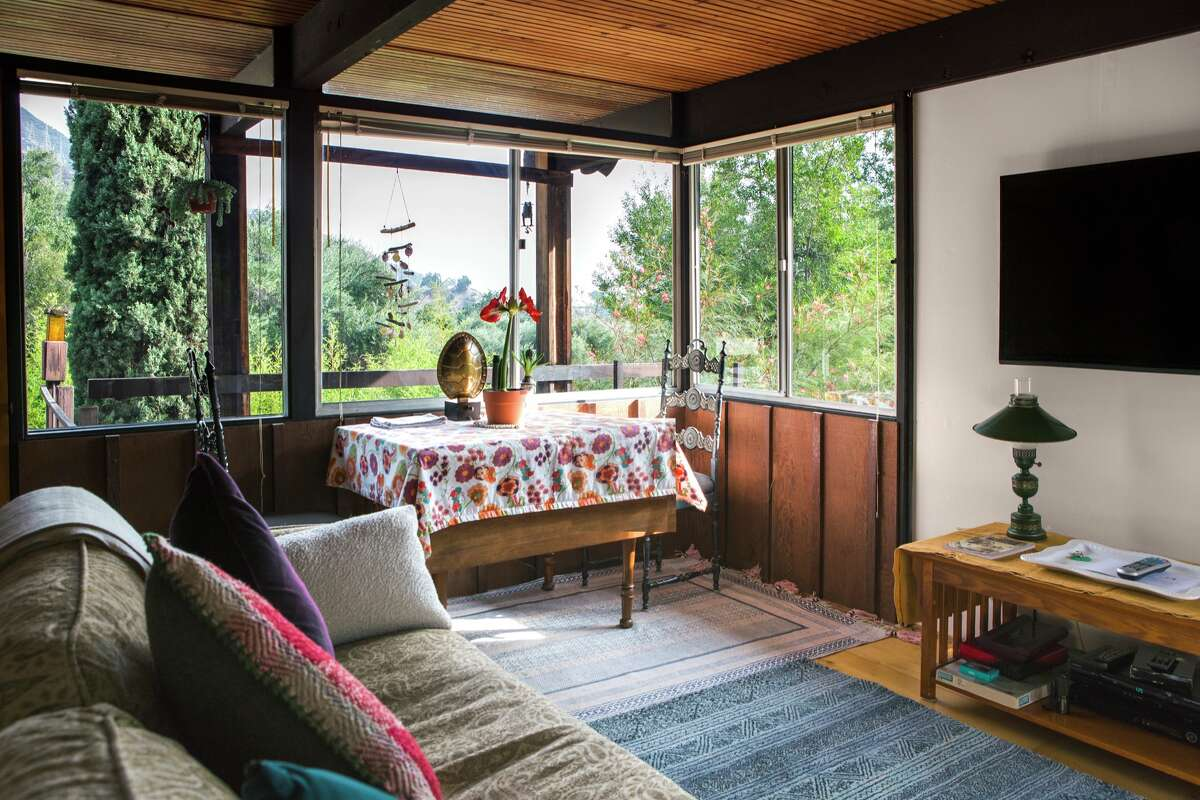 HOT: A more eclectic, bohemian Mid-Century Modern with softer, earthier textures, worldly patterns and pops of color. What's missing in this photo is indoor plants. Distinctive potted plants are trending for 2020, Modsy says.