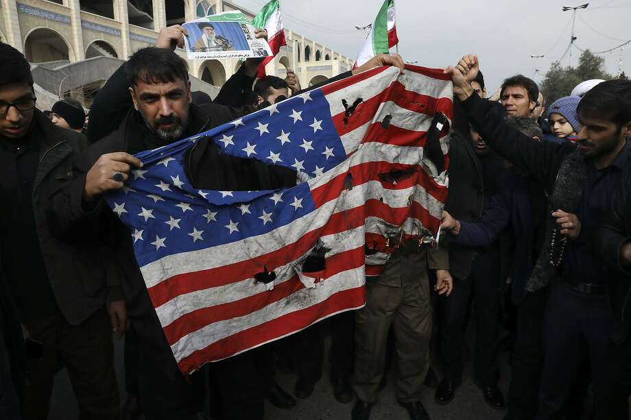 A U.S. flag is burned in Tehran during a protest of the United States' air strike in Iraq that killed Gen. Qassem Soleimani of the Revolutionary Guard's Quds Force, the architect of Iran's interventions across the Middle East. Photo: Vahid Salemi / Associated Press