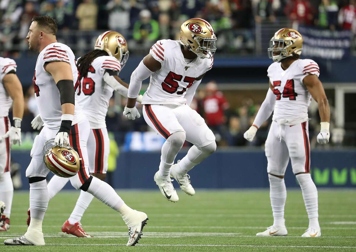 SEATTLE, WASHINGTON - DECEMBER 29: Linebacker Dre Greenlaw #57 of the San Francisco 49ers celebrates a play against the Seattle Seahawks during the second quarter of the game at CenturyLink Field on December 29, 2019 in Seattle, Washington. (Photo by Abbie Parr/Getty Images)