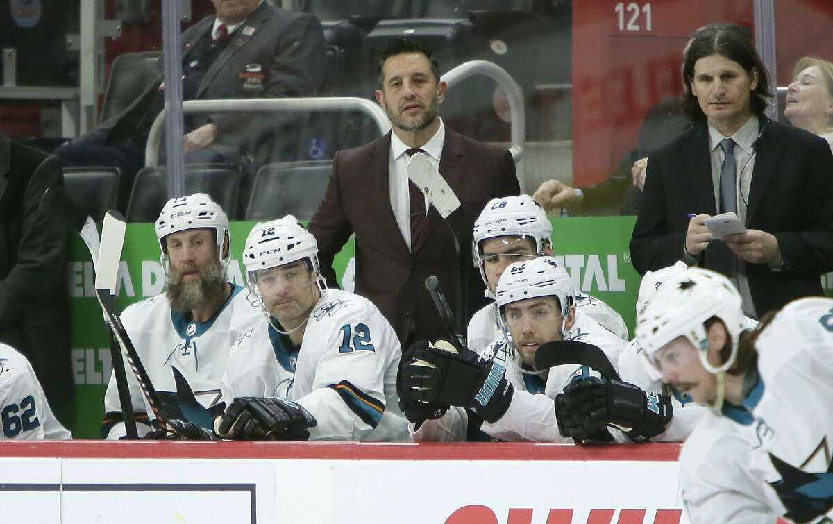 San Jose Sharks interim head coach Bob Boughner watches from the bench during the third period of an NHL hockey game against the Detroit Red Wings Tuesday, Dec. 31, 2019, in Detroit. (AP Photo/Duane Burleson)