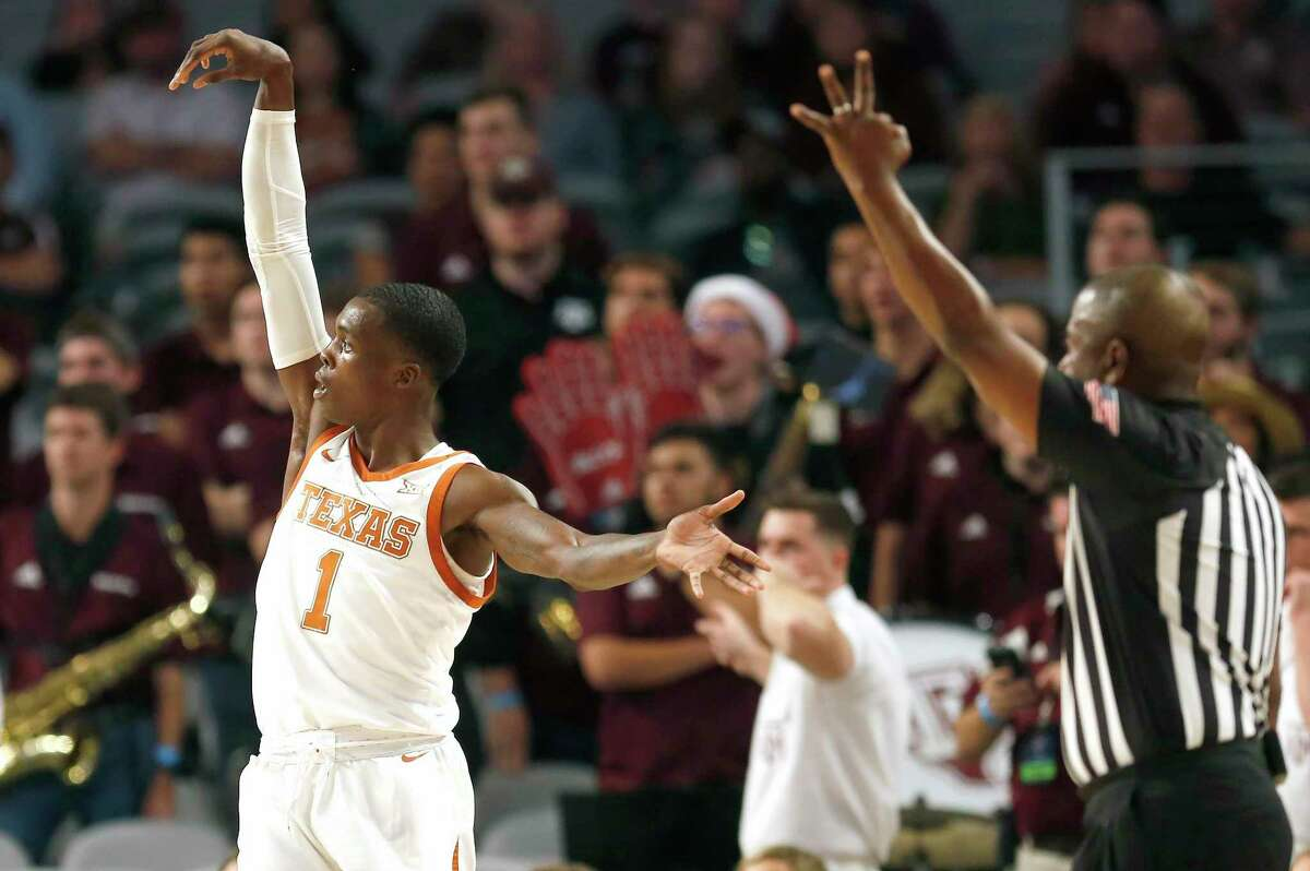 Texas guard Andrew Jones (1) scores a three point basket against the Texas A&M during the first half of an NCAA college basketball game, Sunday, Dec. 8, 2019, in Fort Worth, Texas. Texas won 60-50. (AP Photo/Ron Jenkins)