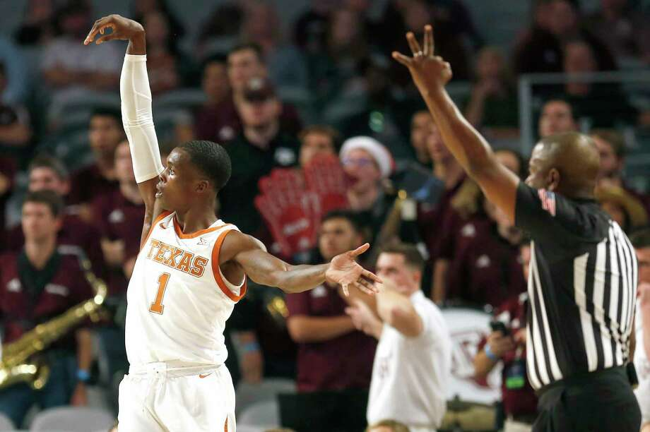 Texas guard Andrew Jones (1) scores a three point basket against the Texas A&M during the first half of an NCAA college basketball game, Sunday, Dec. 8, 2019, in Fort Worth, Texas. Texas won 60-50. (AP Photo/Ron Jenkins) Photo: Ron Jenkins, FRE / Associated Press / Copyright 2019 The Associated Press. All Rights Reserved.