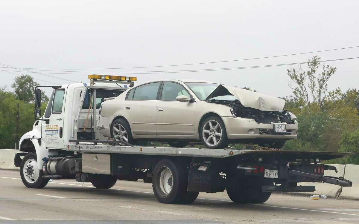 A vehicle involved in a wreck being taken from the scene by a wrecker at Interstate Highway 69 and Fondren Road on Oct. 16, 2018, in Houston.