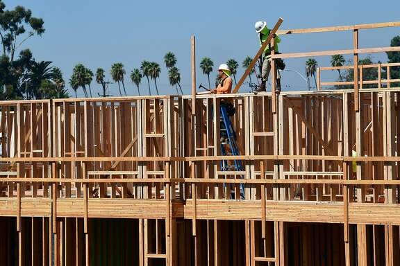 (FILES) In this file photo taken on October 08, 2019 construction workers work on site of a new building in Los Angeles, California. - Permits to build new homes in the United States rose in November to their fastest pace in more than 12 years, government data showed on December 17, 2019 in another sign the American housing sector is heating up. Construction also rose faster than expected, led by a surge in the construction of apartments in the South, according to the Commerce Department figures. (Photo by Frederic J. BROWN / AFP) (Photo by FREDERIC J. BROWN/AFP via Getty Images)