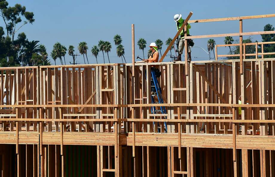 (FILES) In this file photo taken on October 08, 2019 construction workers work on site of a new building in Los Angeles, California. By a one-vote margin, the Pittsburg Planning Commission on Tuesday night approved a 1,500-home project proposed for the hills in the southern portion of the Bay Area city. (Photo by Frederic J. BROWN / AFP) (Photo by FREDERIC J. BROWN/AFP via Getty Images) Photo: Frederic J. Brown, AFP Via Getty Images