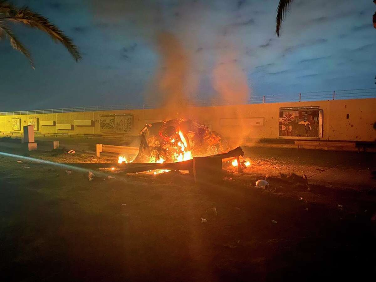 This photo released by the Iraqi Prime Minister Press Office shows a burning vehicle at the Baghdad International Airport following an airstrike in Baghdad thate killed Gen. Qassem Soleimani, the head of Iran's elite Quds Force. Oil prices jumped.
