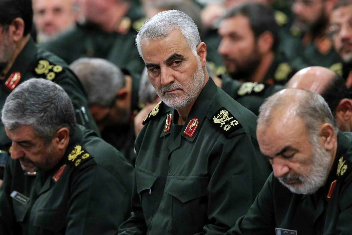 Revolutionary Guard Gen. Qassem Soleimani, center. He was killed in a U.S. airstrike at Baghdad's international airport. Oil prices jumped Friday.